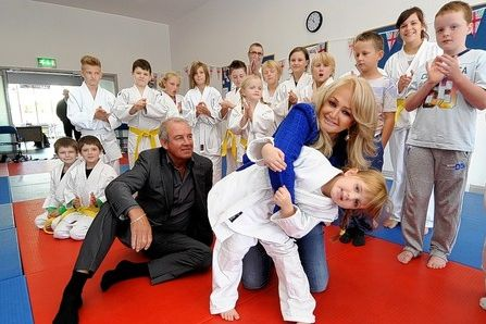 TAKING HOLD Olivia Jones age 5 attempts to throw Bonnie Tyler at the Seiryoku Zenyo Kwai Judo Club in Trallwm as her husband Robert Sullivan, who represented Britain in Judo in the 1972 Olympics, looks on.  Read more: http://www.thisissouthwales.co.uk/Bonnie-s-holding-new-judo-heroes-emerge/story-19805594-detail/story.html#axzz2f3ZfTykG