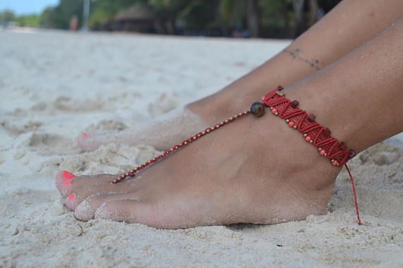 Sexy macrame barefoot sandal in red with Tiger eye bead, brass beads and coral glass beads. Goddess, lightweight, handmade macrame barefoot sandal finished with a powerful Tiger eye bead and embellishes with brass and glass beads. Perfect for Spring and Summer, this barefoot sandal is perfect to use on its own or with flip flops and flats.  One of the most effective of the eye formation stones, Tiger's Eye is ever vigilant, bringing sharpness to one's inner vision and better understanding of…