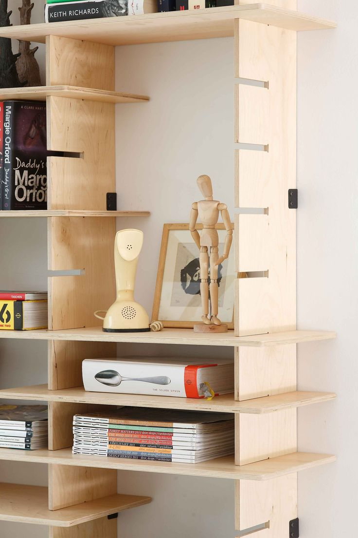 Adjustable plywood shelving with mild steel fasteners designed by Pederson Lennard. Detail.