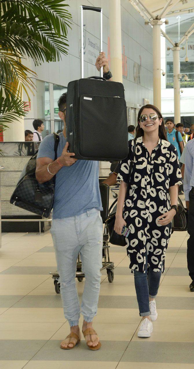 Virat Kohli and Anushka Sharma at Mumbai airport. #Bollywood #Fashion #Style #Beauty #Hot