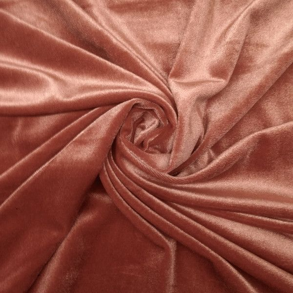 """Stretch velvet fabric is 58/60"""" inches wide, 100% polyester and sold by the yard. This stretchy velvet fabric is great for apparel, costumes, dance wear, decorations and more. The velvet has a silky s"""