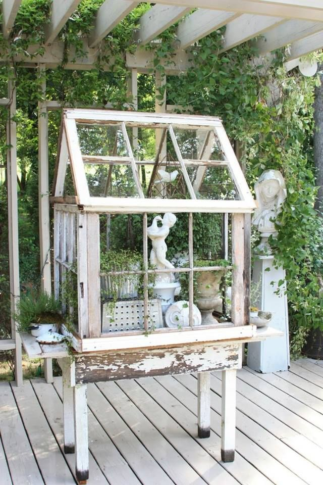 a little green house made from old windows repurposed ..