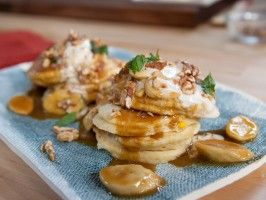Mexican Corn Pancakes with Whipped Goat Cheese, Piloncilo Caramelized Bananas and Walnuts from CookingChannelTV.com