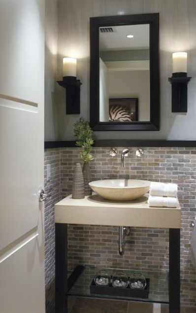 Natural stone mosaic tile for a wainscot adds warmth to a bathroom. #MosaicMonday #TileSensations