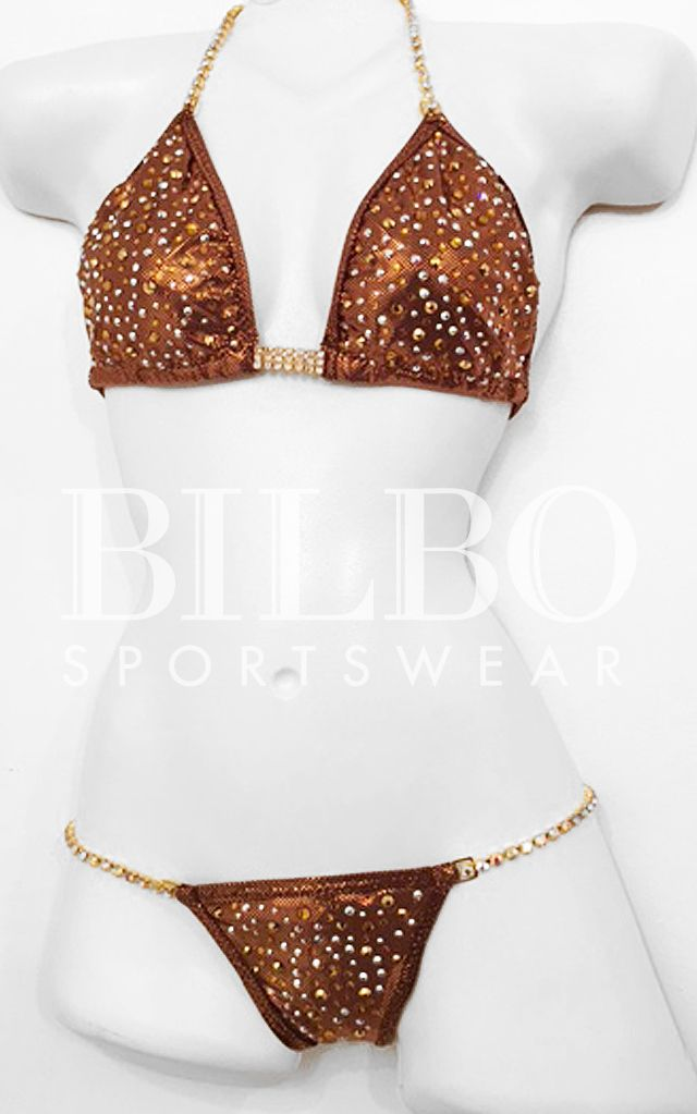Custom suits made to fit! Bilbo suits are made to your specifications in any color and coordinating stone colors. #bikini #bodybuilding #orange #competition #npc #ipl #wbo #ifbb