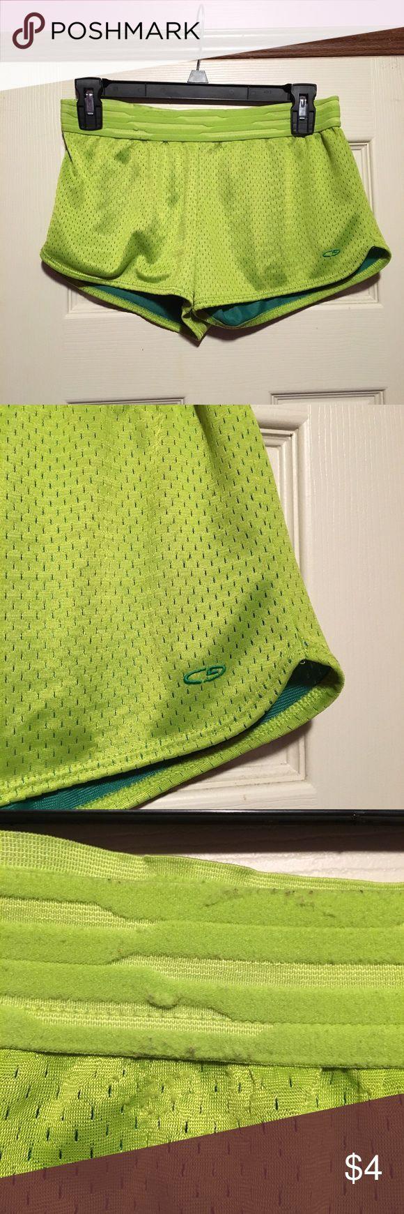 Lime green mesh shorts Short mesh shorts. Size small. Yellow green and green. Has piling and wear on the waistband and wear on the mesh as pictured. Ships next day. Shorts