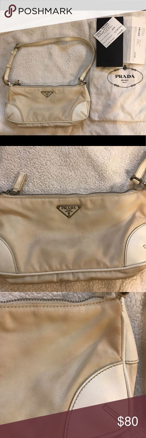 Prada bag Prada White classic nylon bag with dust bag and receipt card. This bag was worn to a pool party in Vegas and it got a few of stain marks on the outside part mostly on the back side of the bag. Inside of the bag is spotless no odor. leather strap perfect . See all photos . This is a Prada classic bag! Prada Bags Shoulder Bags