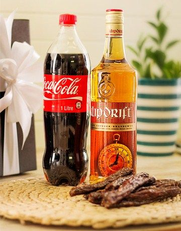 Buy or Send for the real South African at heart, this gift hamper contains a bottle of Klipdrift Export, Coke and a pack of delicious droewors  in South Africa. | Item Code RA1822