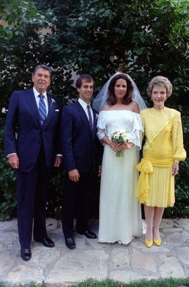 Robert Koch and Patti Davis  August 14, 1984  Patti Davis, daughter of then-President Ronald Reagan, married yoga instructor Robert Koch at the Hotel Bel Air in Los Angeles. Although Davis' lifestyle was far from conservative, she chose a traditional off-the-shoulder white gown for her wedding day; her mother Nancy Reagan opted for a bright yellow silk dress and matching pumps.