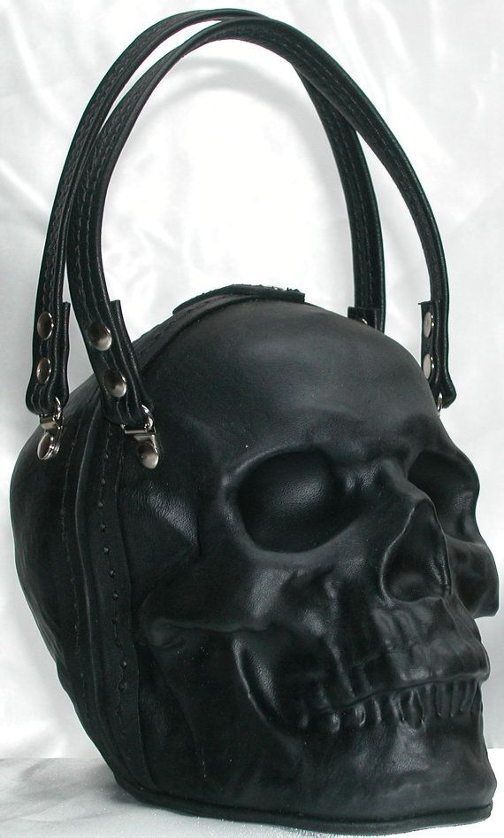 Welcome to Griffin Leather .  Hand formed leather skull clutch bag purse. The leather is formed and tempered to keep its shape. It also has