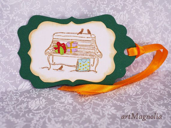 Beautiful Gift Tags in Christmas Colors (Set of 5).  Tags are die-cut from green cardstock. Second, white layer was stamped and hand colored by