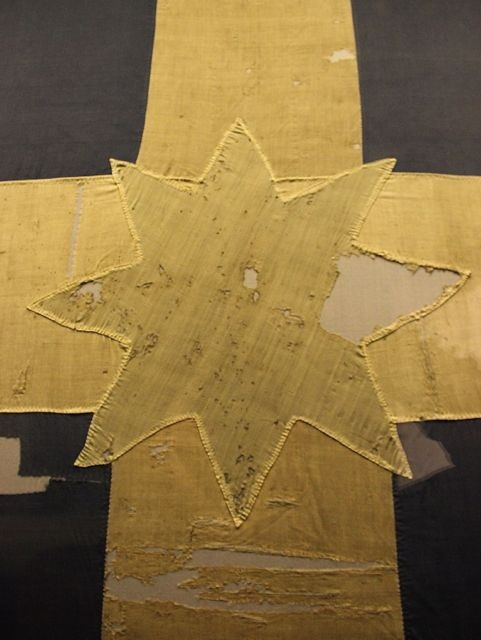 Bullet holes in the Original Eureka Flag, Ballarat