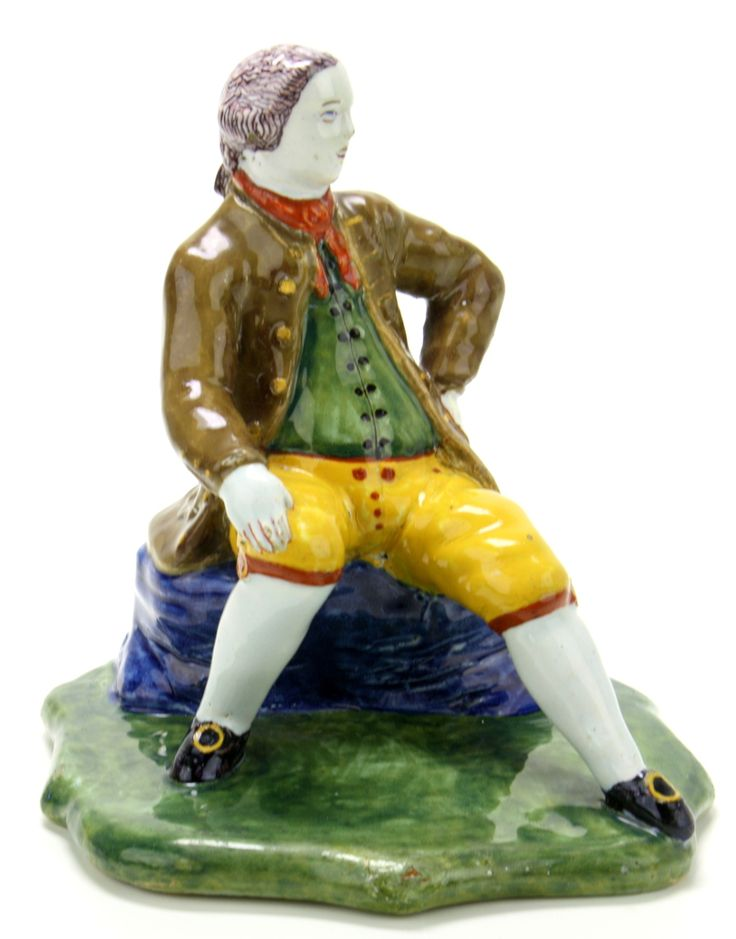 Delfts polychrome earthenware form piece of a sitting man on a blue rock with short yellow pants and a brown coat and a green shirt, ca. 1750, with label Aronson Antiquairs Amsterdam, Height: 14 cm., Jeroen PM Hartgers