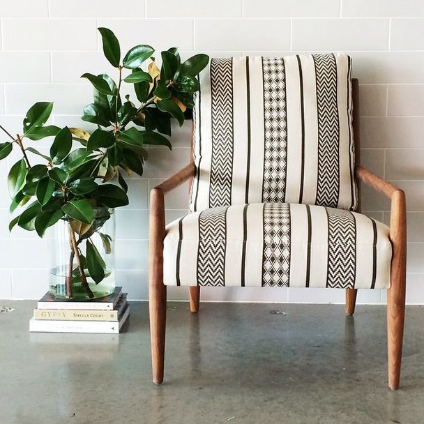 Obsessed with this new chair, #handcrafted in LA from black walnut and covered in a chic graphic print. Available at Salt & Sundry.