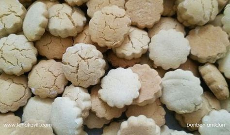 Bonbon Amidon - These melt-in-your-mouth cookies are prepared with amidon (starch), a manioc (yucca) flour. As a child, I loved eating bonbon amidon because they would stick to my palate when eating. .....
