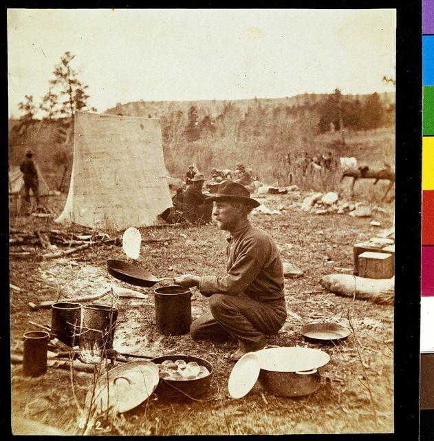 All sizes   John, the Cook, baking slapjacks, via Flickr.
