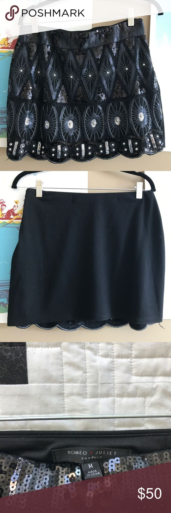 Sequins mini skirt Black and navy sequin mini skirt. Worn once Romeo & Juliet Couture Skirts