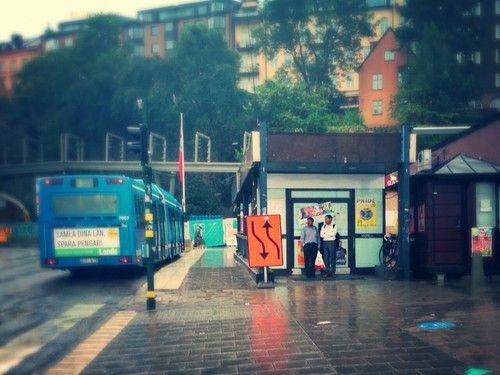 Two men avoiding the rain.