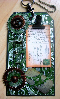 Embossed metal foil card and tag