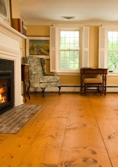 Farmhouse-style wide-plank floors. I did this in my bedroom using plywood, it look almost exactly the same!