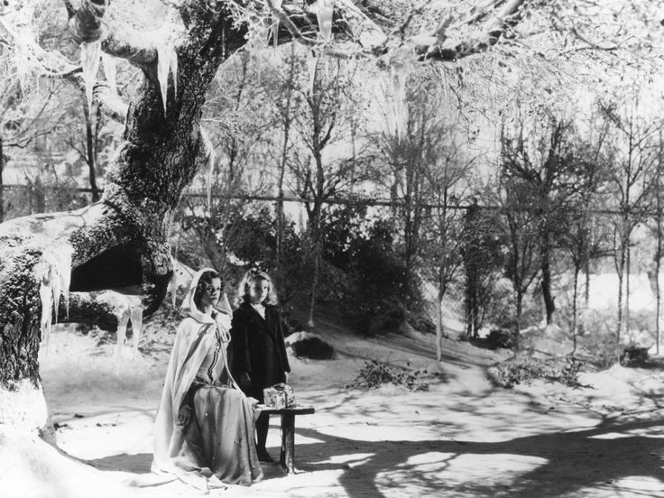 Producer Val Lewton has thickly laid on the winter atmospherics for this scene in 1944 horror-fantasy The Curse of the Cat People. Irena (Simone Simon) returns from the dead suitably attired for the cold in this Salem-styled hooded shawl.