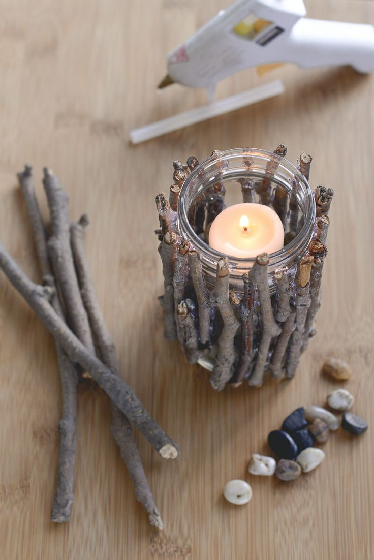 diy rustic candle holders cute candle holders made from a jar, sticks, and some pretty rocks!  www.alyciacreative.com