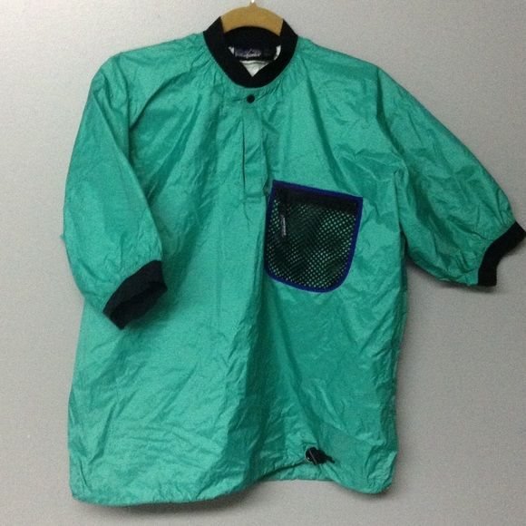 PATAGONIA PADDLING JACKET This is a splash guard paddling jacket.  Waterproof and breathable nylon ripstop fabric keeps you dry on the water.  It is short sleeved  with a neoprene type cuff and collar and has a zippered mesh pocket.  It closes on the bottom with a drawstring and the 1/4 length closure at the neck seals with Velcro and a snap.  It is in excellent condition with no rips, snags or stains. Patagonia Jackets & Coats