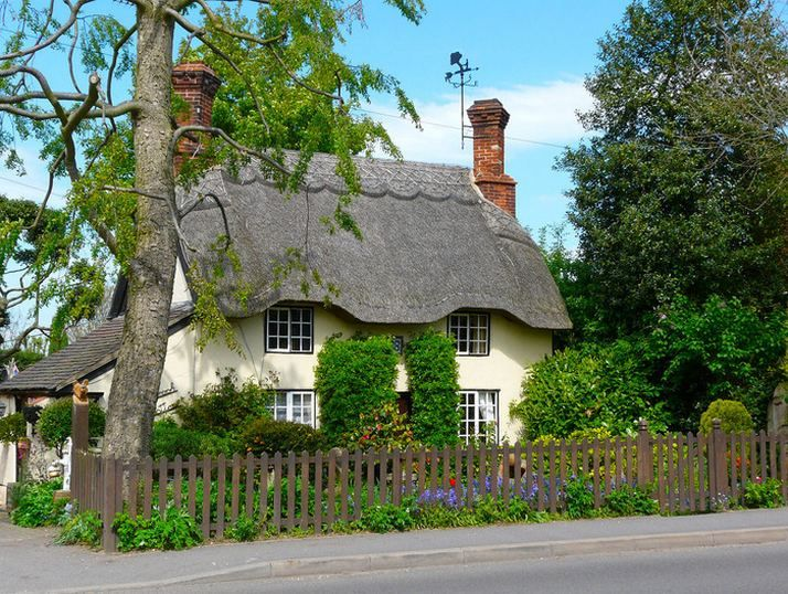 Lovely English cottage with thatched roof.