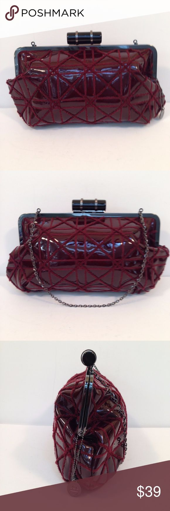 Womens Big Buddha Burgundy Bag Purse Clutch Womens Big Buddha Burgundy Bag Purse Clutch Vintage Faux Patent Leather Measures 14x10x2 with 13 inch drop on metal chain Can be worn as a purse, shoulder bag or clutch with chain inside Overall good condition.   Scratches noticeable upon close inspection of metal of black closure clip.  Not easily noticeable from a regular distance.  1 interior zip pocket Removable Big Buddha Key Chain Big Buddha Bags Shoulder Bags