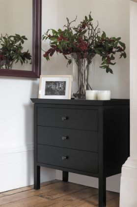The Aldwych three-drawer low chest of drawers by Neptune makes a stylish storage solution for a dining room alcove.