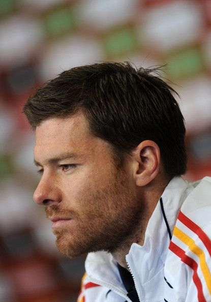 Xabi Alonso Photos Photos - Xabi Alonso of Spain listens to questions from the media during a press conference on June 18, 2010 in Potchefstroom, South Africa. - Spain Training And Press Conference