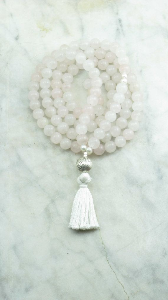 This lovely full 108 mala is made from rose quartz mala beads, fresh water pearls, and Indian sterling sliver. These healing energy gemstones