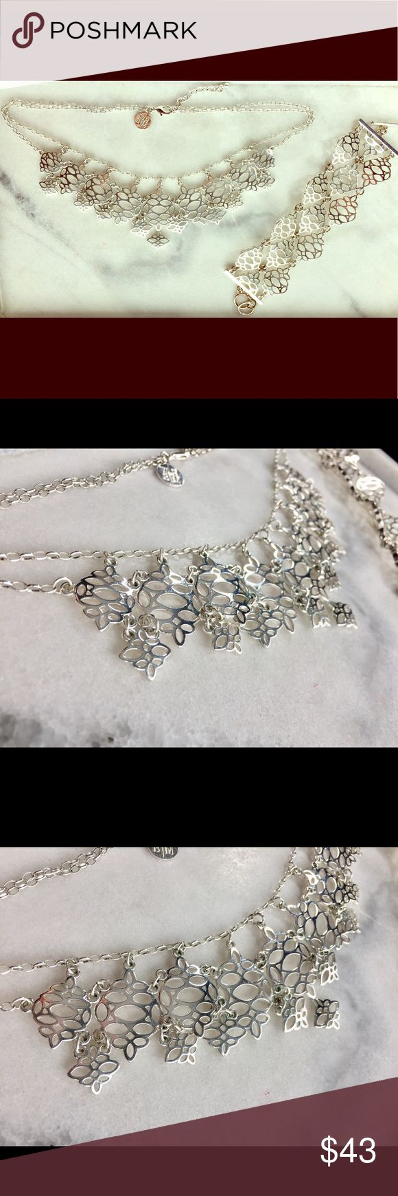 """White House Black Market Necklace & Bracelet Set Gorgeous silver cutout floral pattern necklace & bracelet set from WHBM. Excellent condition. Necklace is 18"""" long with 2"""" extender. Bracelet is 7"""" long with 1"""" extender. Cleaned ultrasonically just for you!  🚨BUY ONE GET ONE FREE SALE ALERT🚨 1. Add one piece of jewelry worth $10 or more to a bundle. 2. Shop my closet for a second piece of jewelry, worth $10 or less. Add the second piece to your bundle. 3. The second piece is FREE! Offer for…"""
