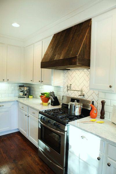 custom vent hood. I like the wood with the white cabinets, backsplash, & marble