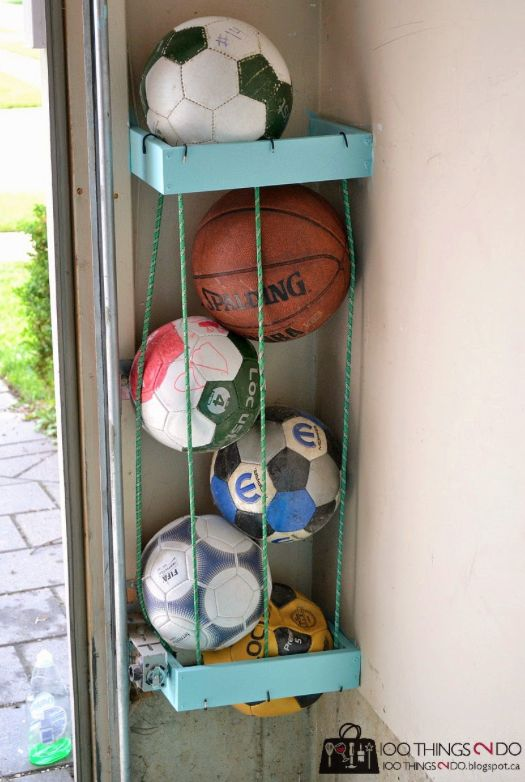Tuck them around two 2x4 boxes to organize all of the sports balls taking up space in your garage. | 35 Brilliant Ways Bungee Cords Can Solve All Your Problems