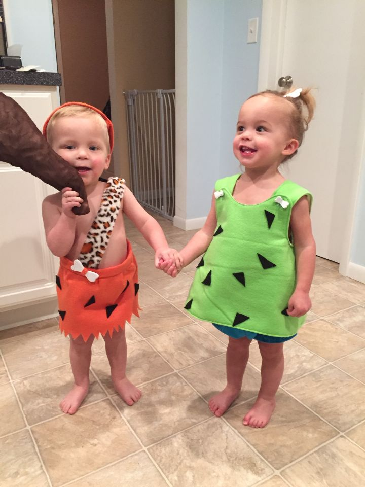 This is how you do twins costumes!! Cutest grand babies ever! Pebbles  and Bam Bam