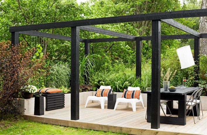 Chunky black timber pergola and lime washed deck. Pinned to Garden Design - Pergolas by Darin Bradbury.