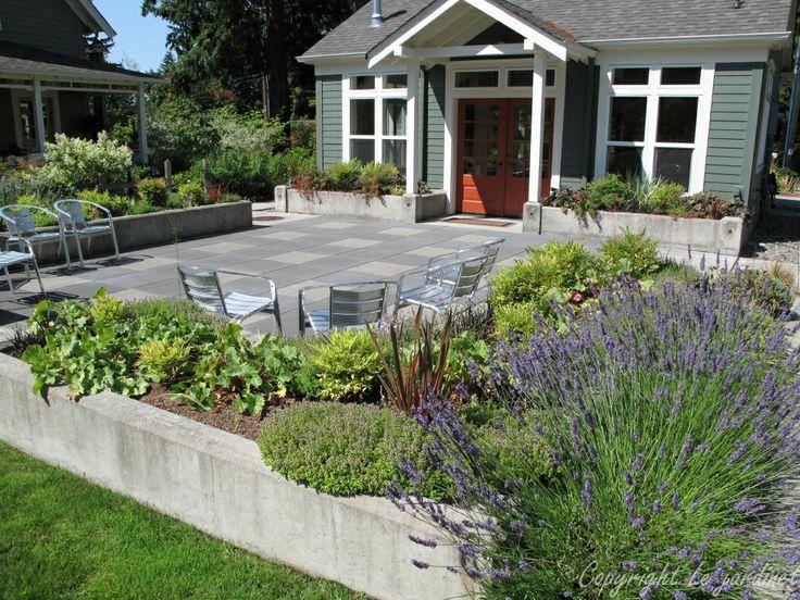 a simple raised border around this concrete paver patio creates a ... - Raised Concrete Patio Ideas