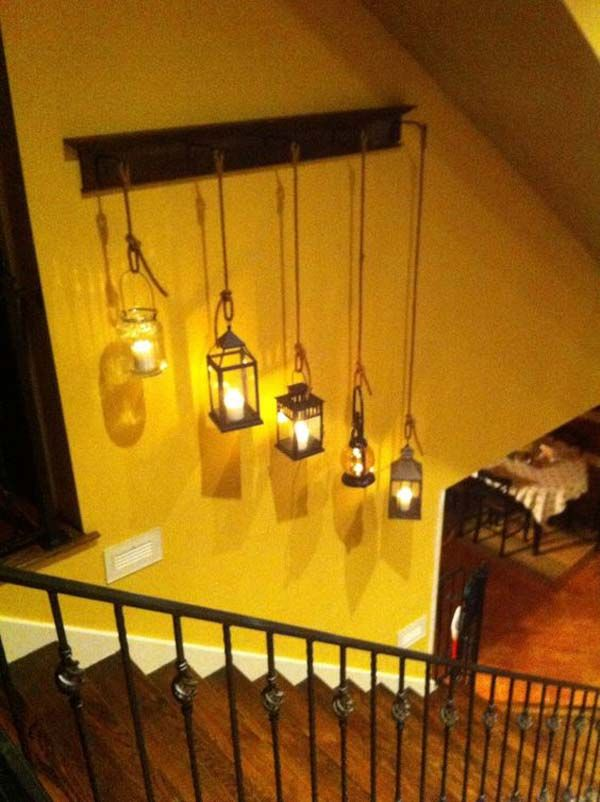 2. Hang several vintage lanterns or mason jar lamps to fill your plain wall.