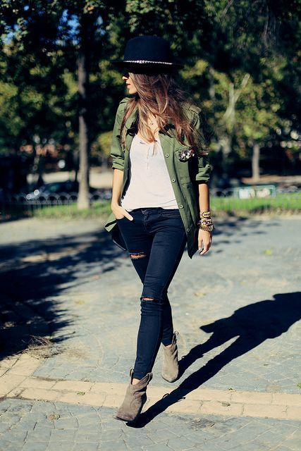 An olive military jacket and navy destroyed slim jeans are perfect for both running errands and a night out. Nude suede ankle boots will add elegance to an otherwise simple look. Shop this look for $114: http://lookastic.com/women/looks/hat-skinny-jeans-tank-military-jacket-ankle-boots/4218 — Navy Wool Hat — Navy Ripped Skinny Jeans — Beige Tank — Olive Military Jacket — Beige Suede Ankle Boots