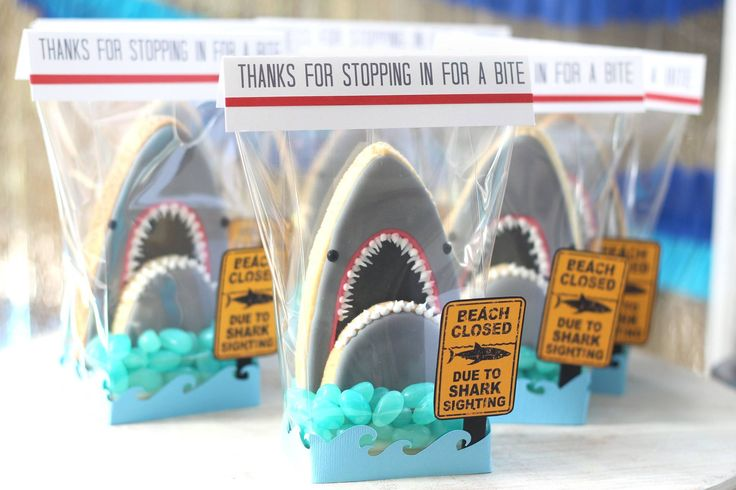 3D Shark head cookies - A cookie favour with blue jellybeans for the water cleverly wrapped with cute sign.  Tutorial on YouTube  Wrapping & photo by Elena Roussakis of Just Me Prints