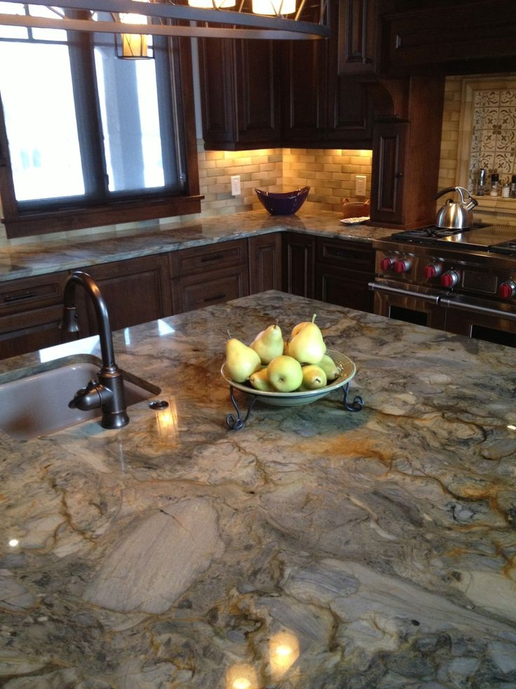 The kitchen - My favorite is the countertop, Fusion; a quartzite, in grays, greens, golds and rust colors.  I love the colors and the movement it has, it's like artwork.