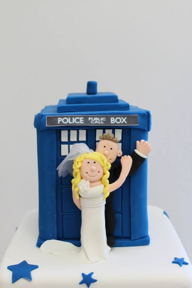 A sweet hand modelled Tardis, complete with cute figurines poking out