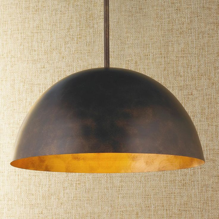 """Large Dome Copper Pendant This large dome shaped pendant with its copper painted finish suits modern to farmhouse to rustic industrial decors. The classic modern shape combined with a light and dark copper bronze finish make this pendant versatile in style. Big enough to use one over a kitchen table or run several down the center of a restaurant. 100 watt medium base lamp required. (10.25""""Hx21""""W)"""