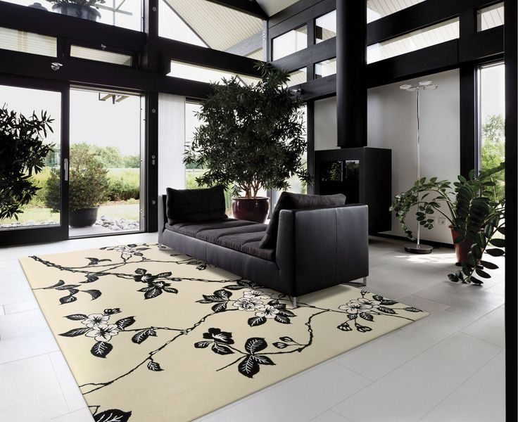 Wow, what an elegant rug by Nourison! With a great Art Deco colour scheme of white, cream and black, this wallpaper-inspired floral print is transformed into an eye catching statement piece.