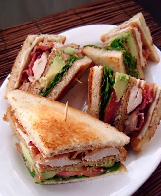 California Chicken Club Sandwich: chicken breasts, salt, pepper, BBQ sauce, bacon, provolone cheese, avocados, lettuce, onion, sliced bread