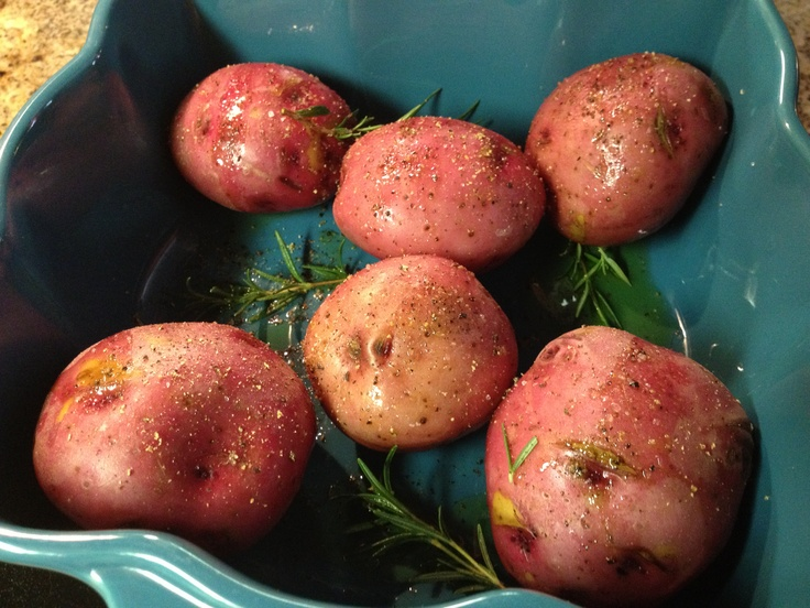 Potatoes with rosemary, dash of salt, pepper, drizzled with EVOO. Going to bake these up and then let them cool for a creamy baked potato soup.