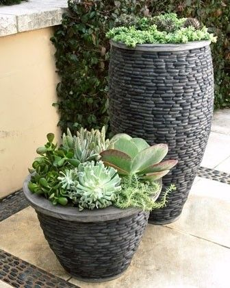 These planters are really unique looking. I love that natural river stone is used in a more structured way.. The rows of stone ringing the planters give a geometric feeling to the them.
