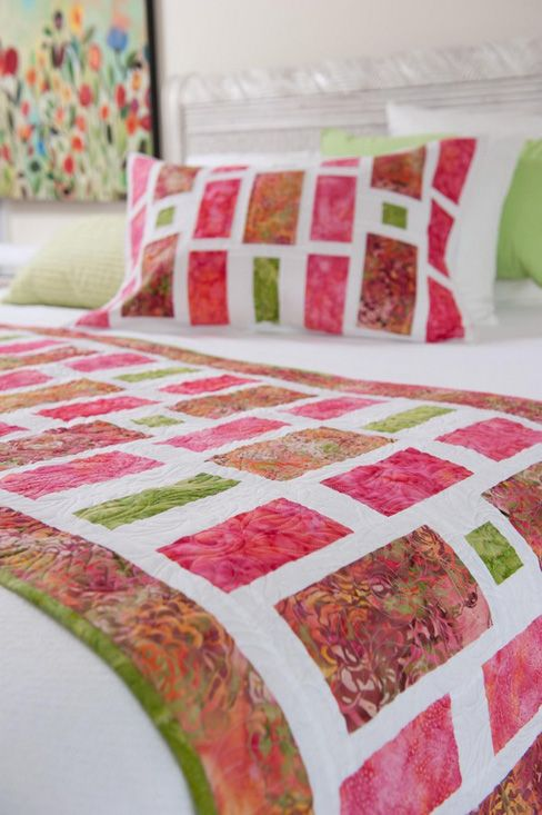 Whistlepig Creek: pretty Watermelon Batiks bed-runner and pillow shams.  Look for the June/July 2012 Quilt Magazine Issue.