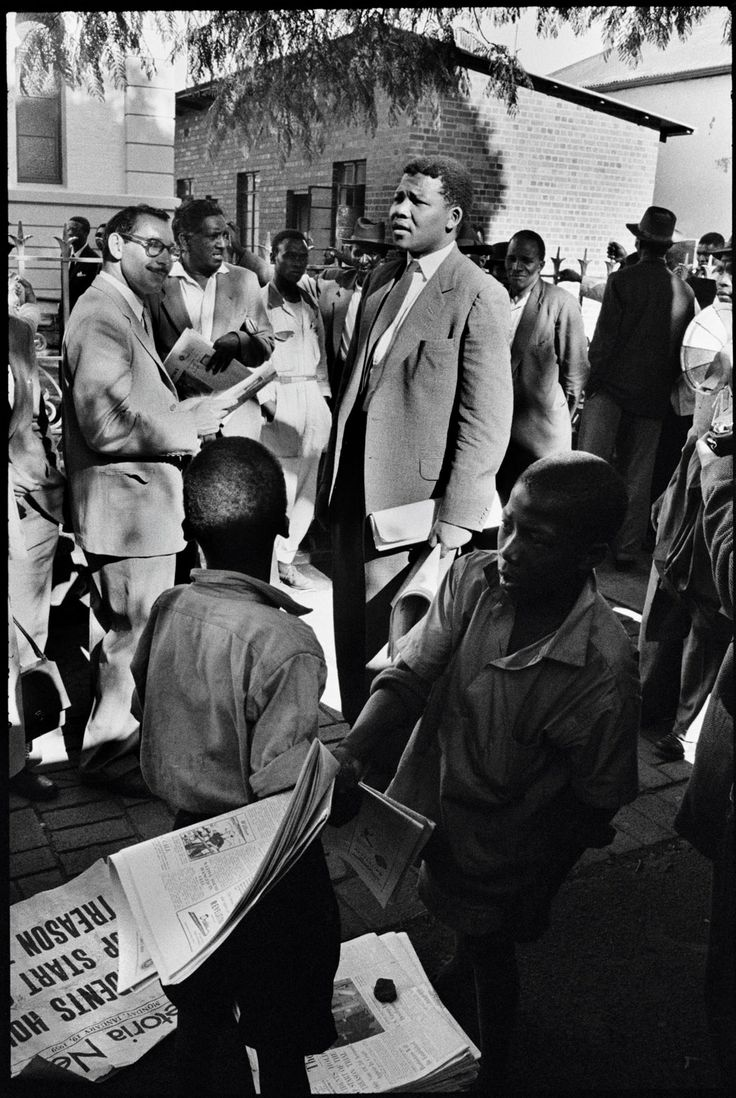 Mandela, then acting as a defense lawyer, outside the Drill Hall during the Treason Trial, the first major trial for treason in Johannesburg, South Africa. 1961. Photograph by Ian Berry/Magnum.